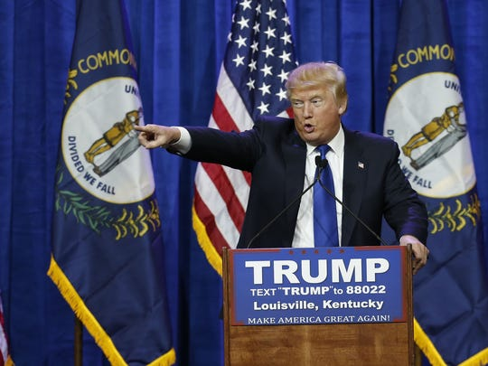 Republican Presidential candidate Donald Trump pointed to a supporter and told he loves them too during a Super Tuesday rally in Louisville. March 1, 2016.