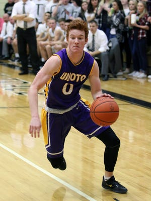 Unioto's Logan Swackhammer drives to the hoop at Miami Trace High School Saturday evening. The Shermans fell to the Panthers, 68-61.