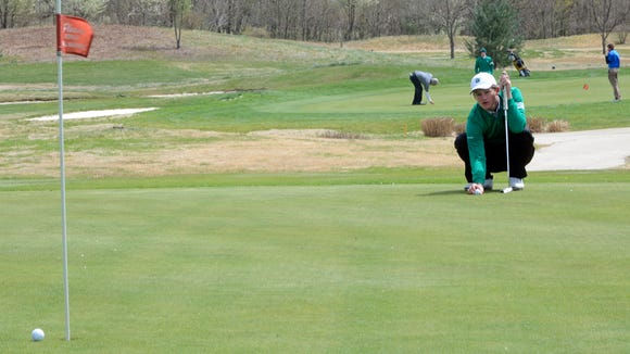 Christ School senior Jonathan Rector lines up a putt during the 2014 Buncombe County tournament at Broadmoor Golf Links.
