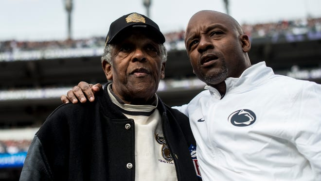 Lenny Moore, (left) former Penn State running back and Pro Football Hall of Famer, chats with football staffer Jemal Griffin (right), as the Nittany Lions defeated Maryland at M&T Bank Stadium in 2015.