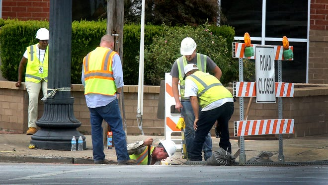 Crews work the site of a gas leak on the corner of Lytle and Maple on Wednesday, Aug. 9, 2016. At least a couple of buildings were evacuated due to the gas leak.