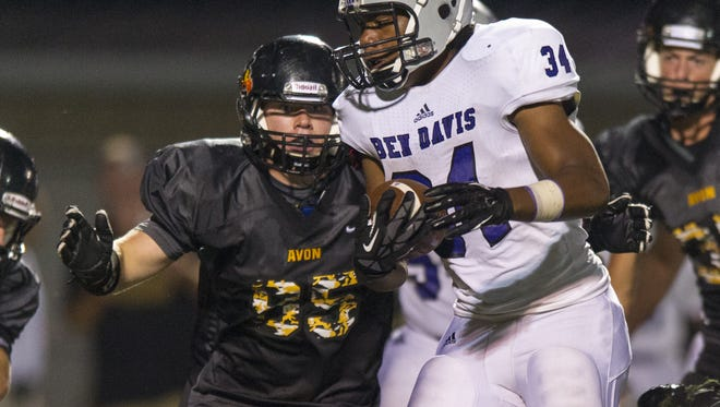 Avon High School sophomore Gunnar Larson (95) lines up to hit Ben Davis High School junior LeShawn Johnson (34) during the second half of action. Avon High School hosted Ben Davis High School in varsity football Friday, August 29, 2014. Ben Davis defeated Avon 57-27.