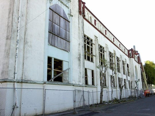 The dilapidated exterior of the grandstand building on the Oregon State Fairgrounds before it is demolished in October 2002.