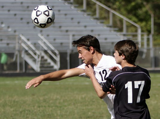 Pinckneys Tyler Allain heads the ball[1].jpg