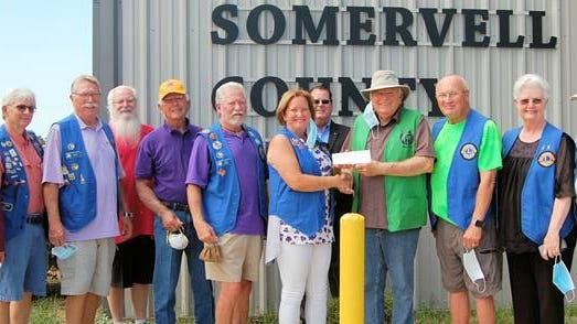 Those who attended Tuesday's Lions Club check donation ceremony at PaPa's Pantry included (from left) First Vice District Governor Stan Hall, Pete Gruber, Max Bly, 2019 District Governor Vince Rosen, Jerry Prather, Rick Clark, Glen Rose Lion President Mary Collier, Robert Kraus, Food Bank Manager Dwight Taylor, Larry Shaw, Deedee Jones, and Stan Myers.