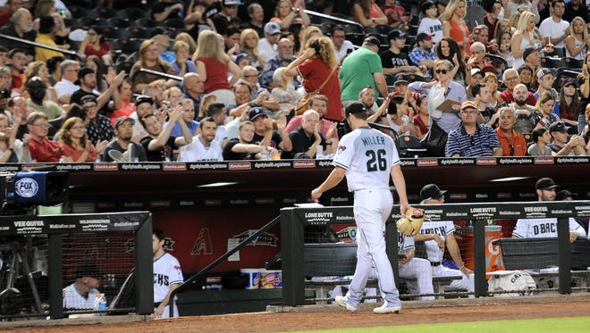 May 13, 2016; Phoenix, AZ, USA; Arizona Diamondbacks starting pitcher Shelby Miller (26) leaves the game against the Arizona Diamondbacks during the sixth inning at Chase Field.