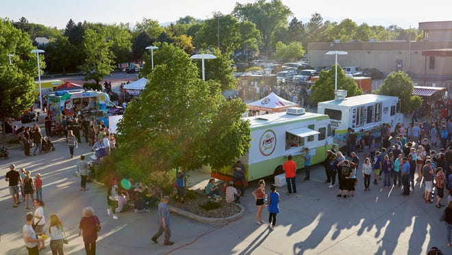 Crowds and food trucks gathered for food, fun and music at the Coloradoan's 2017 Food Truck Festival on Thursday, May 11.