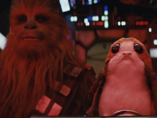 Chewbacca (Joonas Suotamo, left) shares the cockpit