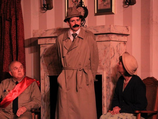 """Sheboygan actor Chris Fontaine playing the bumbling Inspector Pratt, interrogates Colonel Craddock, played by by Sheboygan actor Tom Clegg, and Joan Maple, played by Sue Kaiser, in the murder-mystery comedy """"Murdered to Death"""" at Memories theater in Plymouth."""