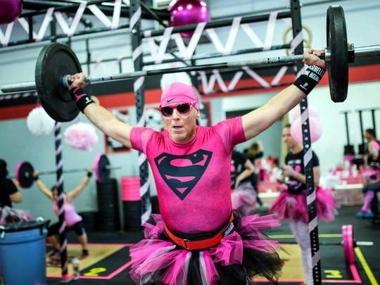 Jeff Rice gets into the spirit at the annual Barbell for Boobs breast cancer fundraiser sponsored by Brighton-Based Flower City CrossFit.