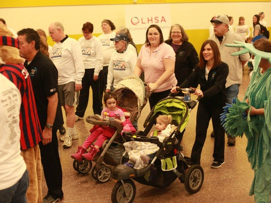 People walk several laps during last year's Walk for Warmth event. This year's in on Saturday, Feb. 20.
