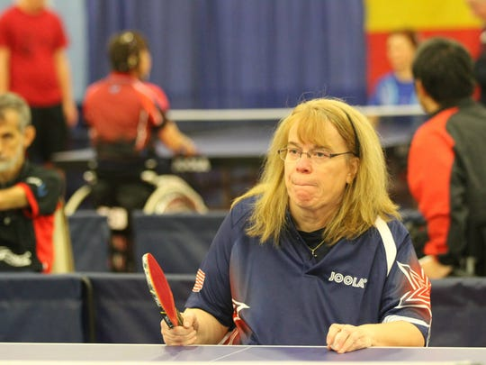 Pamela Fontaine playing table tennis.