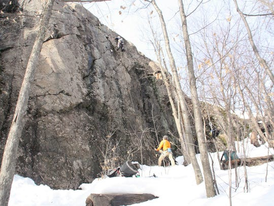 Climbers take on Suicide Wall in early spring with
