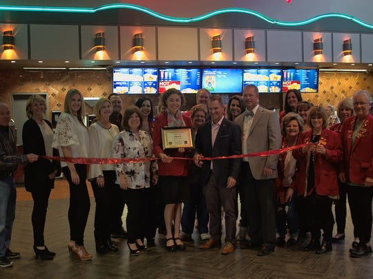 Ribbon cutting at the remodeled Allen 8 theater, located at 1819 E. 20th St.