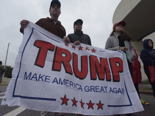 Trump fans from Fairhope, Alabama display a Make America Great Again flag during President Trump's visit on Friday, Dec. 8, 2017.