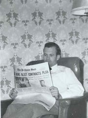 John D. Graham reads The Jackson Sun in this 1952 photo.