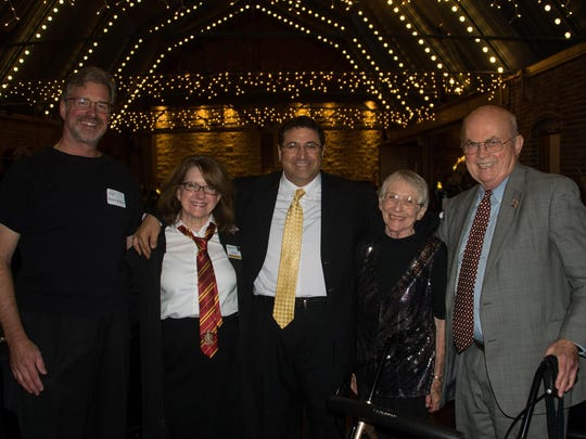 At the ETCDC's annual awards gala are current executive director Wayne Blasius, past president Jan Evridge, 2016 Bruce McCarty Community Impact Award winner Faris Eid, past executive director Annette Anderson and Joe Johnson.