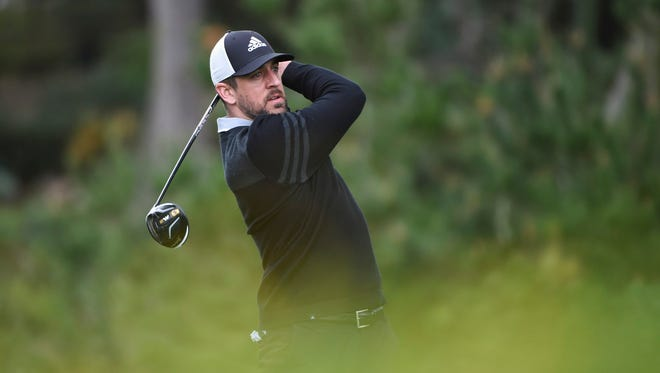 Packers quarterback Aaron Rodgers watches his tee shot on the fourth tee during the first round of the AT&T Pebble Beach Pro-Am golf tournament in 2017.