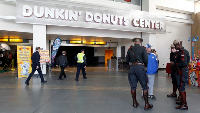 Rhode Island state troopers and Providence police stand in the lobby of the Dunkin' Donuts Center after an accident during the Ringling Bros. and Barnum & Bailey Circus performance, Sunday, May 4, 2014, in Providence, R.I.