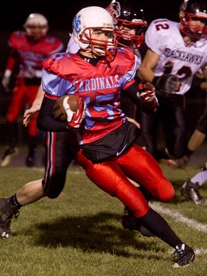 Newman Catholic's Jake Gajewski takes the ball downfield during the opening kickoff during Friday's WIAA Division 7 first-round playoff game against Owen-Withee at Owen-Withee High School.  Megan McCormick/For Daily Herald Media Newman's Jake Gajewski runs with the ball during the opening kickoff during the division seven level one playoffs against Owen-Withee at Owen-Withee High School Friday, Oct. 25, 2013.