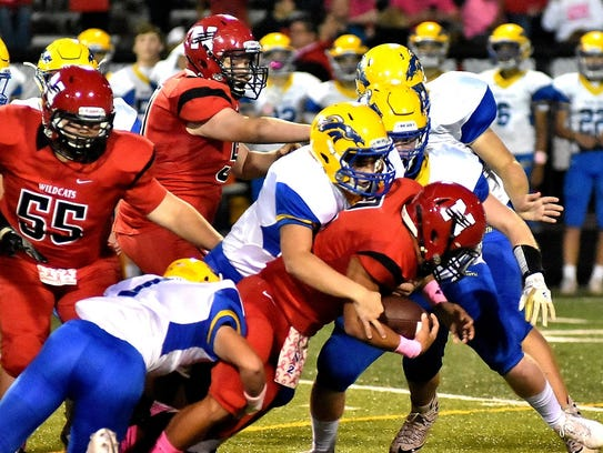 The Newport Central Catholic defense converges on Newport's