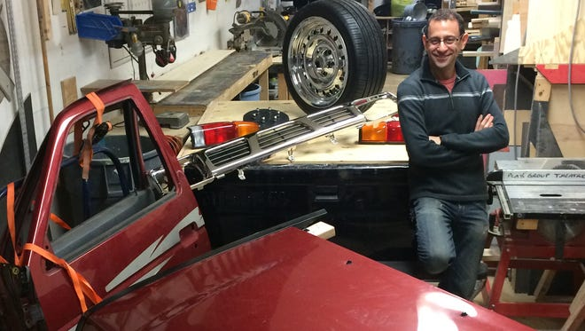 """Steven Abusch is building a Nissan pickup -- the central prop in Play Group Theatre's production of """"Hands on a Hardbody"""" -- from spare parts found on eBay, donated wheels and wood."""