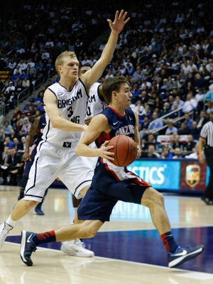 Gonzaga Bulldogs guard David Stockton (11) gets past Brigham Young Cougars guard Tyler Haws (3) and goes the basket during the first half at Marriott Center.