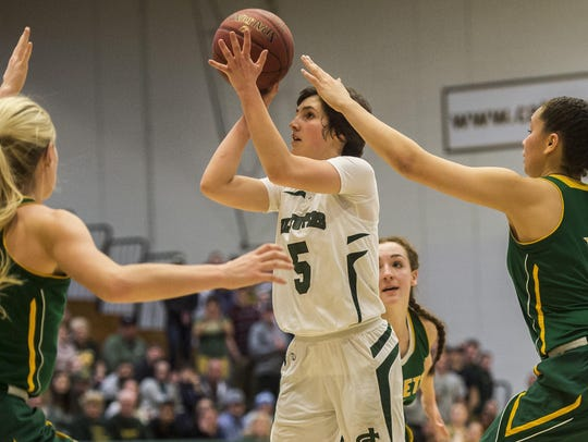 St. Johnsbury's Sadie Stetson goes up for the shot