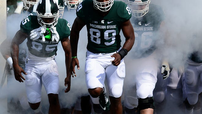 Michigan State defensive end Shilique Calhoun lead the team onto the field at Spartan Stadium on Sept. 26.