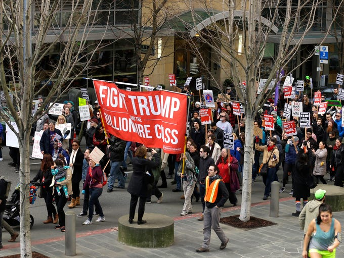 Protesters march in front of the federal courthouse,