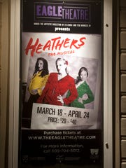 "A poster for ""Heathers: The Musical'' hangs outside"