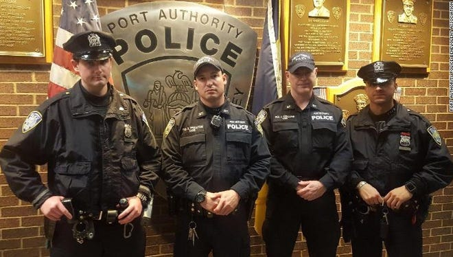 The police officers who apprehended the subway bombing suspect are (from left) Sean Gallagher, Drew Preston, Jack Collins and Anthony Manfredini.