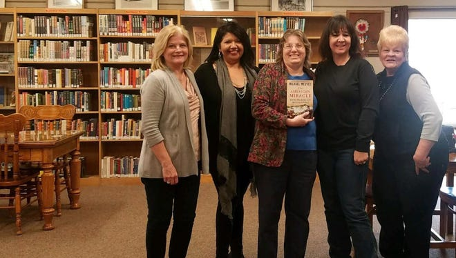 """Republican Women of Otero County present a copy of""""The American Miracle"""" by Michael Medved to Alamogordo Public Library Manager Sharon Rowe on Wednesday. This book was donated in memory of the late Pat Trautman."""