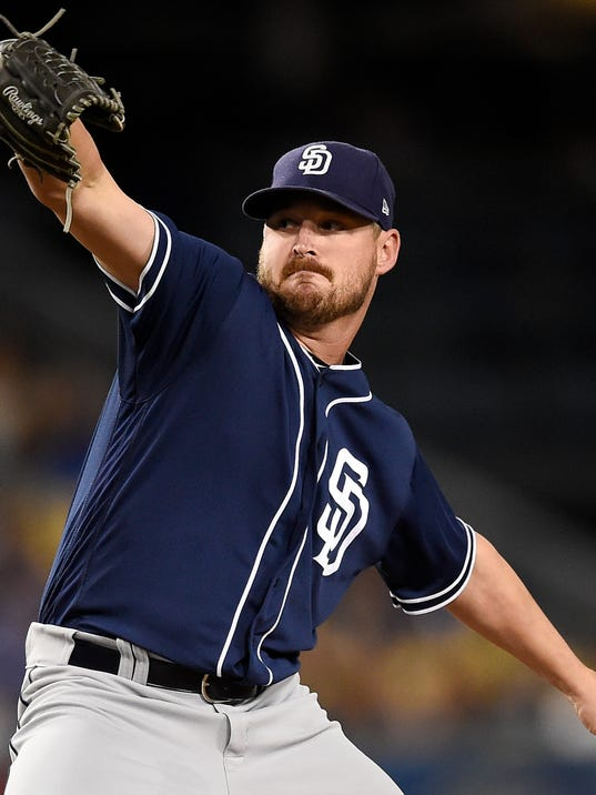 San Diego Padres starting pitcher Travis Wood pitches to Los Angeles Dodgers' Chris Taylor during the first inning of a baseball game in Los Angeles, Monday, Sept. 25, 2017. (AP Photo/Kelvin Kuo)
