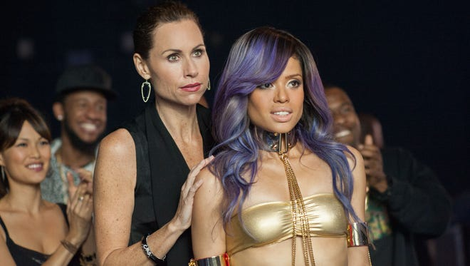 """Minnie Driver, center left, and Gugu Mbatha-Raw in a scene from """"Beyond the Lights."""""""