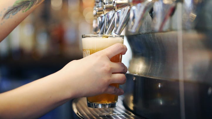 A beer is poured inside the Iowa Taproom on Tuesday,