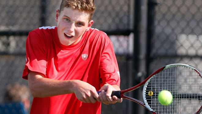 Avery Beaver of Lafayette Jeff with a return to Austin Chyall of Central Catholic at No. 1 singles Wednesday, August 23, 2017, at Lafayette Jeff. Jeff defeated CC 4-1.
