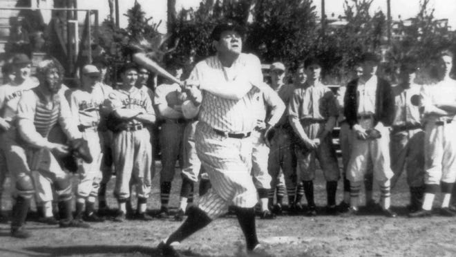 Babe Ruth is shown as he takes a swing during one of the many demonstrations he gave during a preseason baseball school he ran for young boys in the 1930s in Palatka, Florida.