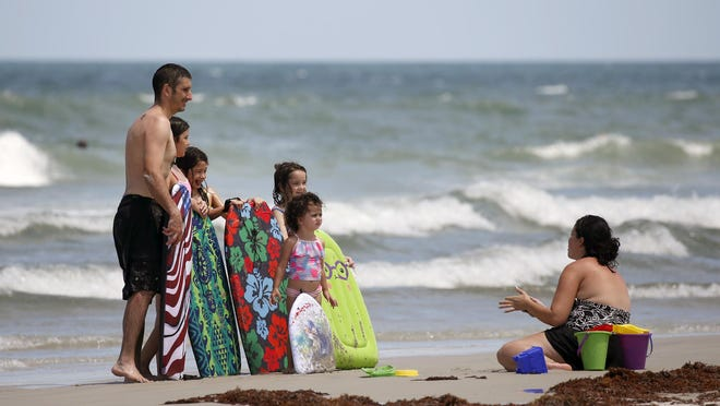 Beachgoers enjoy an afternoon in Daytona Beach Monday, July 27, 2020.