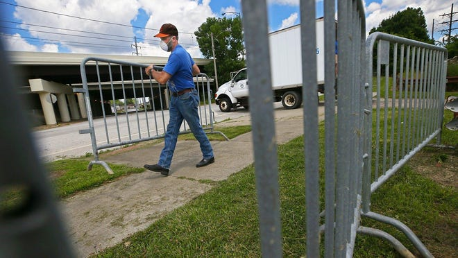 Lock 3 supervisor Greg Obringer unloads guardrails to be set up near Summit Lake Community Center ahead of this weekend's Fourth of July fireworks show.