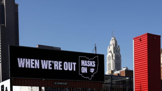 An electronic billboard Downtown promotes the wearing of masks in Ohio during the coronavirus pandemic.
