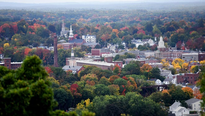 Foliage is seen around the city of Dover, as seen from the top of Garrison Hill Tower.