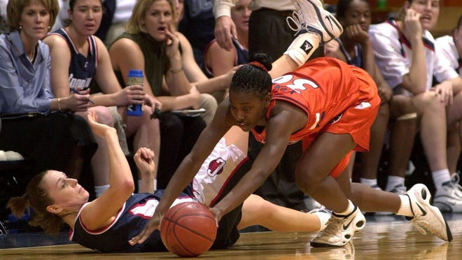 Former Harlem and Illini star Aminata Yanni (30) picks up a loose ball against UConn as a freshman.