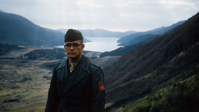 Marine Corps Sgt. Jay Fred Gough stands in Sagami Bay during the 1950s.