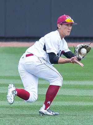 NMSU's Brent Sakurai grabs a ground ball on Sunday as the Aggies took on Yale at Presley Askew Field.