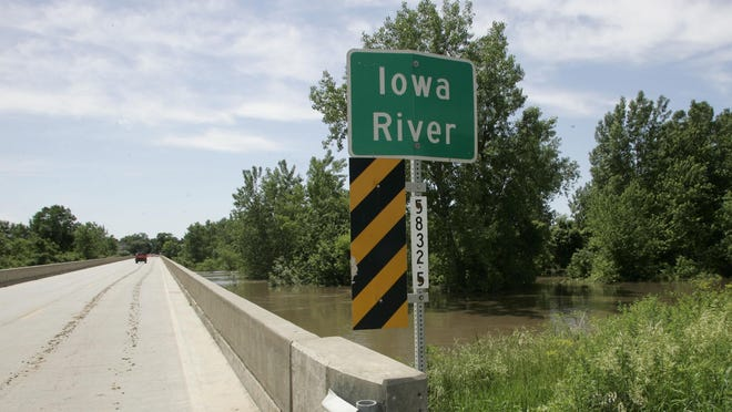The Highway 99 bridge over the flooding Iowa River has been replaced. This is the view during the high waters in June 13, 2008 in Wapello.