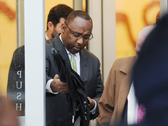 Former Corrections Commissioner Chris Epps leaves the federal courthouse in downtown Jackson after pleading guilty to federal charges.