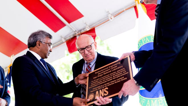 The American Nuclear Society Nuclear Historic Landmark Award is presented to the REDC facility at the Radiochemical Engineering Development Center at Oak Ridge National Laboratory on Wednesday, May 16, 2018. Pictured, from left, are ORNL Director Thomas Zacharia, Isotope Program Manager Emory Collins and Alan Icenhour, associate lab director for nuclear science and engineering.
