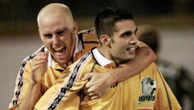 Bill Sedgewick and Michael Kirmse, shown here celebrating Kirmse's game-winning goal against Dallas (MLS) in the 1999 U.S. Open Cup quarterfinals at Frontier Field, will be inducted into the Rhinos' Hall of Fame on Saturday.