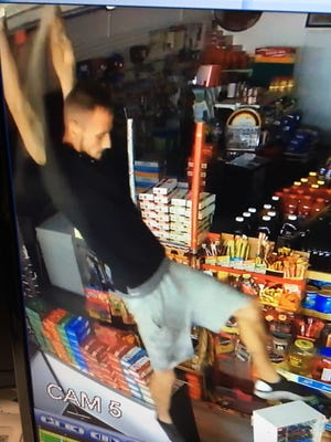 A surveillance camera captured a shot of a man who allegedly burglarized a North Fort Myers convenience story Wednesday, making off with lottery tickets.